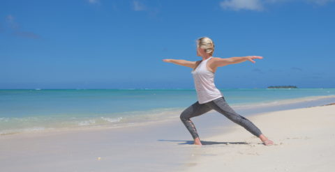 A woman is practicing Tai Chi at the Micro beach