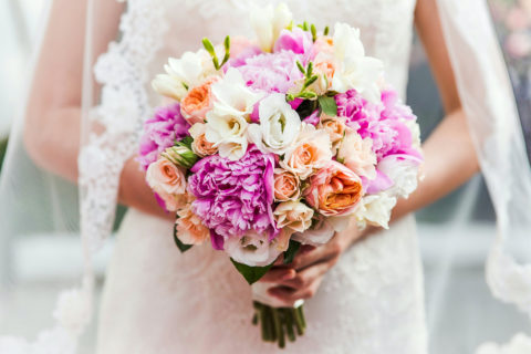 A Bride is Holding Bouquet