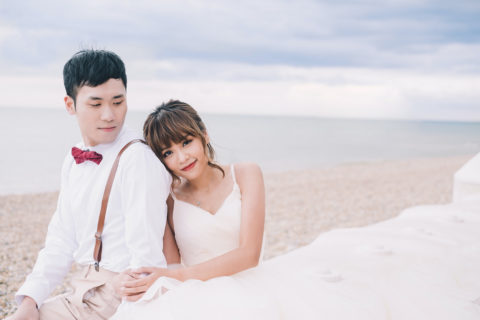 Asian Bride and groom are taking photo at the beach