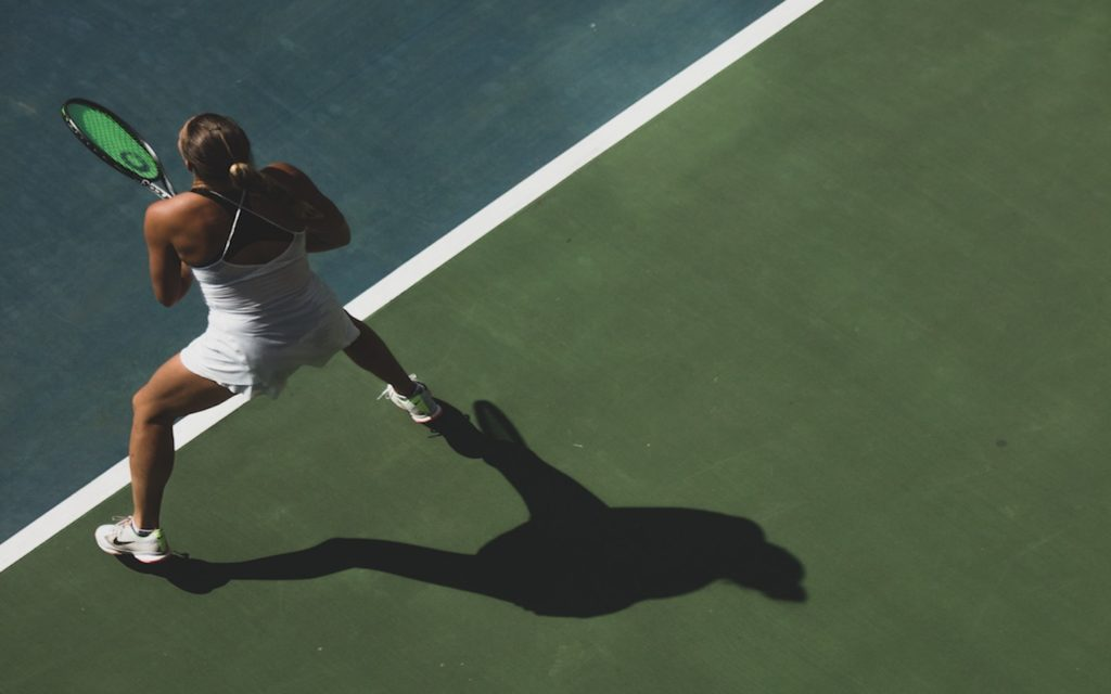 A lady is playing tennis